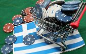 Shopping Cart Full Of Casino Checks Over The Flag Of Greece To Gamble