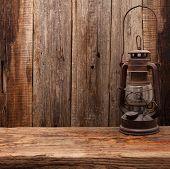 lamp oil lantern retro barn wooden background