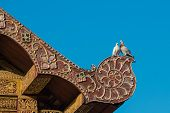 Two Lover Pigeon On The Ancient Thai Art Style Roof
