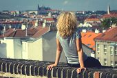 Girl Sitting On The Roof Of A House