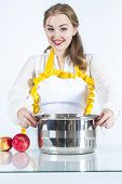 picture of homemaker  - Photo of smiling homemaker with pan on white background - JPG