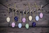 Many Colorful Easter Eggs Hanging On Line  With Frame