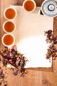 Still life of tea cups and herbs