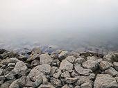 Rocky Dam on River Background