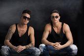 Two hip trendy male friends in studio shot