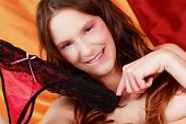 pic of wamp  - Portrait of an young naked and seductive woman holding her panties - JPG