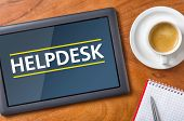 Tablet on a desk with the text Helpdesk