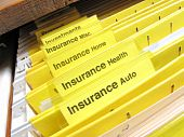 stock photo of file folders  - Open file cabinet showing yellow insurance files - JPG