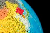 stock photo of flag pole  - map with miniature flag of China - JPG