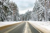 Winter road in snowy forest