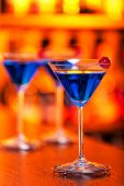 foto of oz  - Blue Martini cocktail shot on a bar counter - JPG