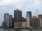 Lower Manhattan Silhouette On The Cloudy Sky Background