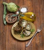 pic of artichoke hearts  - A plate with cooked artichokes decorated with fresh rosemary on wooden - JPG