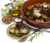 foto of artichoke hearts  - Artichokes served with olive oil pepper and salt isolated on white - JPG