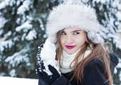 pic of snowball-fight  - Girl preparing a snowball for a snowball fight - JPG