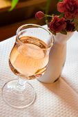 Glass With Rose Wine And Flower