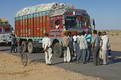 Truck drivers talk on the road in Jamba, India.