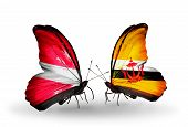 Two Butterflies With Flags On Wings As Symbol Of Relations Latvia And Brunei