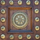 Gold Studs And Symbol On Wooden Door
