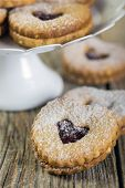 stock photo of linzer  - Linzer cookies in the shape of heart close up - JPG