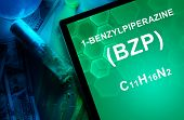 Tablet with the chemical formula of benzylpiperazine (BZP).
