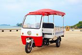 picture of rickshaw  - asian rickshaw vehicle parked on the road - JPG