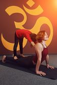 image of om  - Mother and child yoga practice on the background of the Indian symbol of OM - JPG