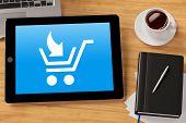 Symbol for E-commerce on a  tablet computer on a desktop (3D Rendering)