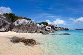stock photo of virgin  - Stunning beach with unique huge granite boulders - JPG
