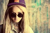 pic of dreadlock  - Modern teenage girl with blonde dreadlocks over grunge background - JPG