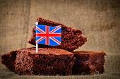 picture of brownie  - Home baked chocolate brownies with a Union Jack flag on a rustic hessian background - JPG