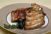 stock photo of roasted pork  - Roasted pork ribs with thyme and spices - JPG