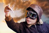 picture of bomber jacket  - Boy dressed up in pilot outfit at sunset sky - JPG
