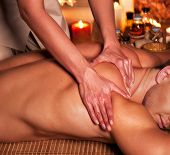 stock photo of therapist massage  - Man getting massage in spa - JPG