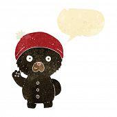 stock photo of crazy hat  - cartoon waving black teddy bear in winter hat with speech bubble - JPG