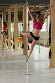 picture of pole dance  - Photo of beauty woman practicing pole dance - JPG