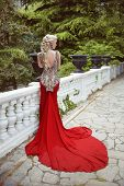 picture of evening gown  - Fashion elegant blond woman model in red gown with long train of dress - JPG