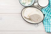 stock photo of curd  - Dairy products on wooden table - JPG