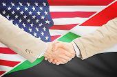 foto of sudan  - Businessmen shaking hands  - JPG
