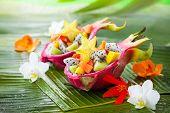 foto of dragon fruit  - Exotic fruit salad served in half a dragon fruit - JPG