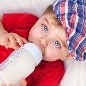 image of formulas  - Portrait of cute little baby boy drinking milk - JPG