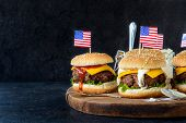 image of burger  - Greound beef mini burgers on wooden boardselective focus and blank space - JPG