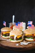 picture of beef-burger  - Mini ground beef burgers with American flag on wooden backgoundselective focus - JPG