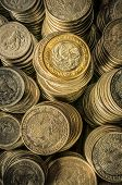 pic of golden coin  - A golden coin with an eagle over stacks of silver coins business wealth and success concept - JPG