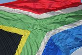 stock photo of nelson mandela  - Close-up of colourful South African flag on a sunny day ** Note: Soft Focus at 100%, best at smaller sizes - JPG