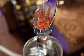 image of hookah  - Embers in a cup of hookah at the asian cafe - JPG