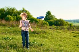 pic of frisbee  - Girl playing frisbee in the park in summer - JPG