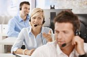 stock photo of people work  - Young customer service operators working in office - JPG