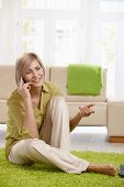 stock photo of mobile-phone  - Cheerful woman speaking on mobile phone - JPG