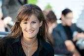 Closeup portrait of happy young businesswoman, smiling.